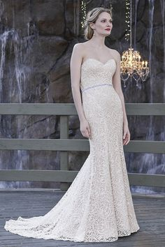 Casablanca Style 2252 | Gateway Bridal & Prom | SLC | Utah | Worldwide Shipping |  Supple non-beaded lace over satin creates a beautiful Fit and Flare silhouette for Hyacinth. This strapless gown looks just as soft on the eyes as it feels to the touch. This slimming gown wraps the bride in a soft, lace embrace. A sheer illusion back bodice makes an alluring statement as the Hyacinth bride walks down the aisle, turning heads with every step. A rhinestone belt at the natural waist adds…