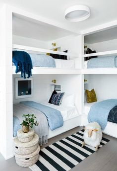 Visit a minimal Sag Harbor-style beach house designed by Maureen Winter McDermottBeachy minimalism takes center stage in this Breezy Sag Harbor HomeTwin room over full-floor bed in nature with wooden stairs L-shaped bunk beds with