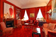 The red, red library in the former duplex mainsonette of William and Pat Buckley.