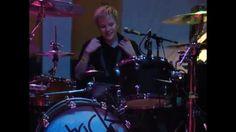 Patrick Stump playing drums.
