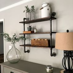 DIY: Pipe Shelving. Good idea for my son's room.