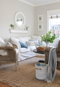 A pretty and fresh whole home paint color scheme using warm neutrals and calming blues. See photos of the paint colors used in actual rooms.