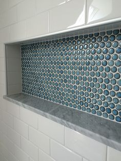custom shower detail. inset niche with penny tiles, marble base and subway tile wall. Portland, Maine renovation. East End Carpentry. Email egibbs@maine.rr.com for more info