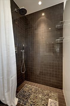 Dark brown shower tiles