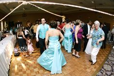 the Holy Trinity Banquet Room can hold up to 200 people and is tastefully decorated.  It's a nice room for a very large dance floor!  Great room for a wedding DJ like me!