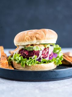Try this quinoa beet burger made with flax and oats. They're delicious piled on a bun with spicy garlic aioli for a vegan meal that's easy to make with basic ingredients. The burgers hold together well and can be fried, baked or grilled. This recipe is vegan, gluten-free, oil-free and sugar-free.