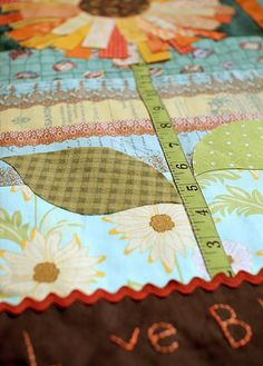 Scrappy Sunflower Quilt - I love the tape measure stem :)