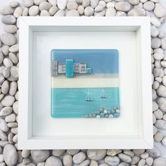A gorgeous fused glass picture, framed and ready to hang. Please note each one is hand made and unique, and therefore may differ slightlyfrom that shown.  Size 23cm x 23cm (frame)