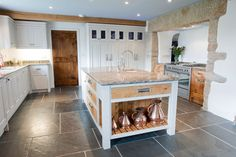 PIPPY OAK DETAIL: Set within a painted kitchen, the Pippy Oak features in this kitchen really make an impact. There are pan drawers, scribed into the granite walls on either...