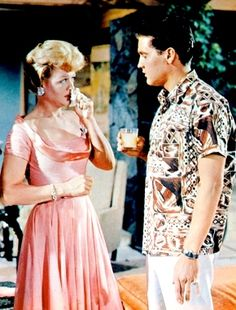 """""""BLUE HAWAII"""" 1961 - Elvis with Angela Lansbury who played the role of his ditzy mother even though she was only 35 years old at the time and Elvis was 26. She began her career in 1944 in a movie called 'Gaslight', which quickly earned her an Academy Award nomination for Best Supporting Actress."""
