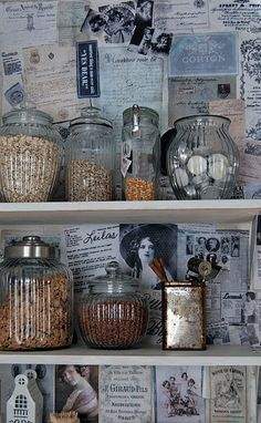 Pantry ~ Love the old paper on the walls and the clear glass canisters. Great idea wall paper would be cute too!