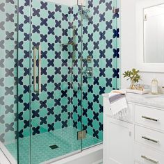 Getting creative with tile is an easy way to add instant interest to any small bathroom. Go bold in pattern and color in the shower, with clear-glass doors so that it becomes a permanent focal point of the little space.