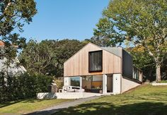 The Stradwick House by Space Division is clad in brick on the base, and a cedar rainscreen covers the top level.