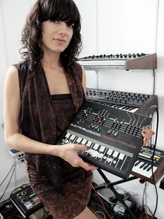 Veronica Vasicka of Minimal Wave poses with a synthesizer of the sort used by some minimal wave artists (Photography: Damien Neva)