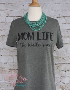 A personal favorite from my Etsy shop https://www.etsy.com/listing/272797128/funny-mom-shirts-mom-life-the-hustle-is