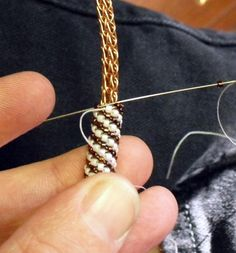 Tutorial: Peyote stitched slide bead I finished up this copper Viking wire woven necklace today. A tutorial for the peyote stitched slide beads that I weave around Viking wire necklace.Tangible Daydreams: Tutorial: Peyote stitched slide bead/ Always Seed Bead Tutorials, Beading Tutorials, Beading Ideas, Beading Techniques, Beading Supplies, Beaded Jewelry Patterns, Beading Patterns, Loom Beading, Peyote Stitch Tutorial