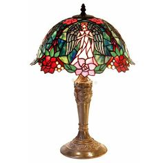 Bring an air of delicacy to your living room or office with this classic Tiffany-style angel lamp modeled after the designs of Louis Comfort Tiffany. The motif of an ethereal angel surrounded by rose