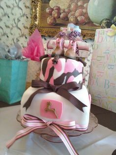 Pink camo, white and John Deere boots all made from fondant.  Add some John Deere Grosgrain Ribbon and tractor resin!