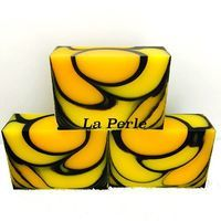 soap technique - yellow & black cold-process soap by La Perle. Layer of black and then drops, I'm guessing. Great for Halloween..