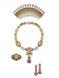 AN ANTIQUE PINK TOPAZ, ENAMEL, DIAMOND AND GOLD PARURE   Comprising: a comb tiara set with a fringe of oval pink topazes to the openwork gold, blue enamel and diamond decoration; a necklace/choker with removeable links supporting a detachable plaque brooch and topaz pendant; a pair of earrings with detachable pendants (may be added to necklace/brooch combination); and a brooch with pendant hoop, all of neo-classical and foliate design, mounted in silver and gold, circa 1840
