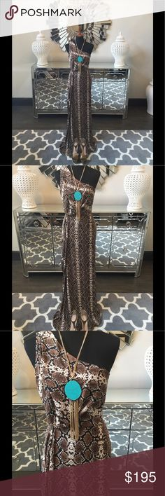BCBG MaxAzria Maxi Gown Stunning BCBC MaxAzria off the shoulder Maxi gown. Gorgeous animal print fabric. Drapes and flows effortlessly. Gathered waist shows off your curves. Side zip. Fully lined. New with tags. Look fabulous at your next event! BCBGMaxAzria Dresses Maxi