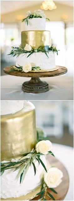 Elegant white and gold wedding cake, white floral cake topper, green leaves, wooden cake stand // JoPhoto
