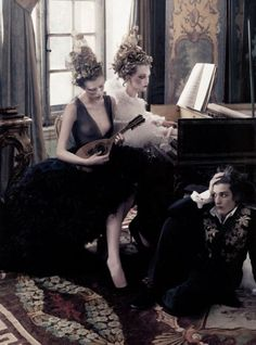 """Models: Karen Elson, Gemma Ward, and Louis Garrel, photographed by Annie Leibovitz for """"French Twists"""" editorial, Vogue May 2004."""