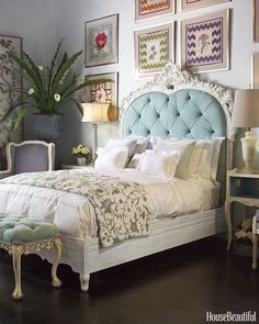 This guest bedroom from reader Florence de Dampierre, featured in House Beautiful's June 2014 issue, combines a vibrant series of playful, nontraditional artwork atop the tufted headboard for an eclectic and eye-catching gallery wall. - HouseBeautiful.com