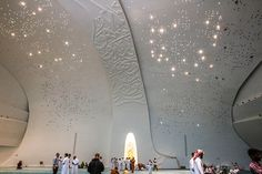 (Previous post continuation) A look inside Education City's glittering new mosque in the Qatar Faculty of Islamic Studies. The mosque, a large white cavernous structure with Quranic verses embossed. Mosque Architecture, Sacred Architecture, Religious Architecture, Education Architecture, Modern Architecture, Ceiling Plan, Star Ceiling, Doha, Education City
