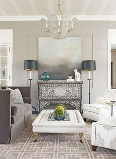 Mix grey with warmer neutrals. Create a relaxing living room with a tightly controlled palette of toning greys and neutrals. Mid-tone grey walls and flooring provide a warm, inviting backdrop for a neutral sofa and rug and delicately patterned cushions.