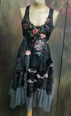 Inspired by late Victorian deep mysterious shades, this romantic floaty dress is hand dyed in shades of dusty teal, dark green, dark grays.. the material is slightly sheer ; reworked with vintage trims and textiles, many handworked details here. The neckline is trimmed with vintage torn