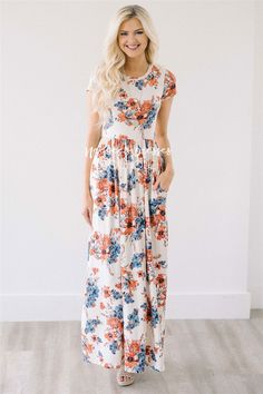 Our super soft floral dresses just got a make over! Now coming in floor length, this maxi dress is as pretty and comfortable as they come! Pretty black maxi dress features a cute tropical floral print, elastic waist, 3/4 length sleeves and pockets!