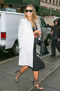 Turning the sidewalk into her own catwalk! Elle Macpherson shows off her designer ensemble as she strolled the streets of New York on Tuesday ahead of TV appearance