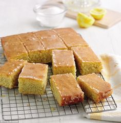 Treat yourself to Mary Berry's Lemon Drizzle Traybake Mary Berry's lemon drizzle traybake is an all-time favourite as it's so moist, really easy to make and full of zesty, zingy flavours Great British Bake Off, Tray Bake Recipes, Dessert Recipes, Desserts, Baking Recipes Uk, Lemon Drizzle Traybake, Banana Split, British Baking, Food Cakes