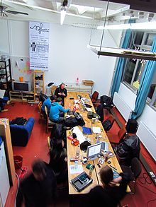 A hackerspace (also referred to as a hacklab, makerspace, or hackspace) is a community-operated physical space where people with common interests, often in computers, technology, science, digital art or electronic art, can meet, socialize and/or collaborate. Hackerspaces can be viewed as open community labs incorporating elements of machine shops, workshops and/or studios where hackers can come together to share resources and knowledge to build and make things.