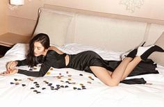 Liu Wen flaunts her long legs in a black gown with sexy cutouts