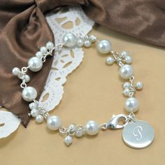 Personalized Romantic Pearl Bracelet (Cathys Concepts B9270SI)   Buy at Wedding Favors Unlimited (https://www.weddingfavorsunlimited.com/personalized_romantic_pearl_bracelet.html).