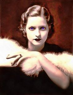 Vampire Woman with Intense Blue Eyes This canvas print is sure to make a statement in any space. It's hand-stretched on a poly-cotton blend canvas with a matte finish coating.