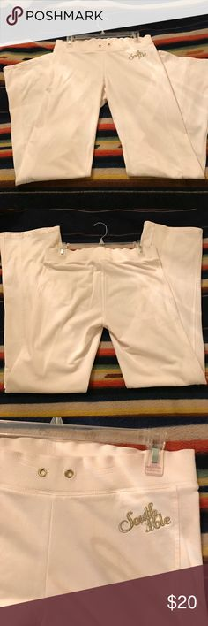 South Pole pants Cream colour, slightly stretched on waist band with SP initials on front. Sz 32inches by 33 length. 60% cotton. Missing the draw string. South Pole Pants Straight Leg