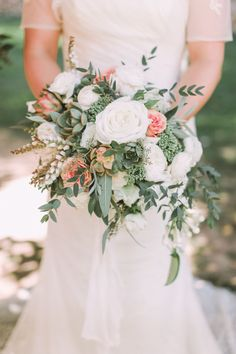 Giant White Roses + Peach Roses + Succulent Green Bouquet - Absolutely Lovely!   See the wedding on SMP: http://www.StyleMePretty.com/2014/06/02/rustic-california-celebration-layered-with-pink/  Photography: SargeantCreative.com -- Floral Design: ArtWithNatureDesign.com
