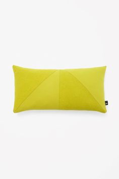 This rectangle-shaped cushion is made from triangular panels of upholstery wool in subtly contrasting colours. It is filled with soft feathers.