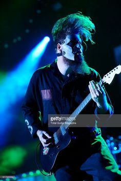 Portrait of American musician Jim Root, guitarist with heavy metal group Slipknot, performing live on stage at Motorpoint Arena in Cardiff on February 8, 2016.