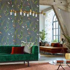 Harlequin Saona | 2018 Designer Wallpaper Collections | TM Interiors A motif on moody grounds enlivened with invigorating pops of colour, Saona portrays an abstract flower head, resembling an iris or lily, as well as bulrushes and pondlike motifs. An easy-to-use wallpaper from the Zapara collection, it has a pretty overall layout with a pleasing, gentle flow. Saona 111755 Lagoon/Zest By Harlequin Wallpaper