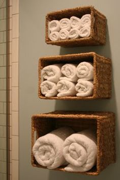 Towel storage in wicker baskets.