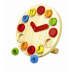 Children's wooden toy teaching clock from Pintoy. Buy it from Cottage Toys at www.cottage-toys.co.uk #educational toys #children #wooden toys