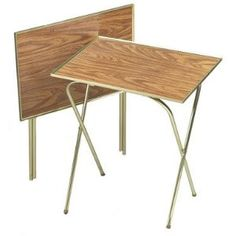 Metal TV Tray Stands.  I remember being envious of friends whose families ate in front of TV...now I'm grateful that we didn't.  YIKES!!!!  We still have those exact tables!  My husband piles all his books etc on them.