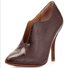 """Vince camuto signature pump Burgundy colored all leather, python embossed pump. Pointy toe , split vamp. 4""""inch heel. Cushion leather foot bed ! Very comfy! Luxury brand to Vince Camuto. Sold out everywhere Vince Camuto Shoes Ankle Boots & Booties"""
