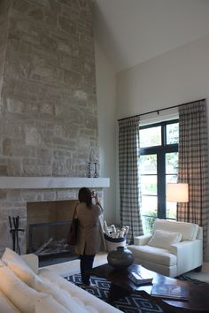 This fireplace is bigger and doesn't have a hearth- MARTHA MOMENTS: A Dreamy Modern Farmhouse