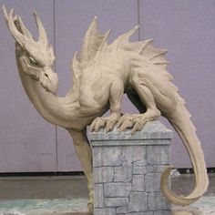Conjose 2002 Dragon  7' tall 16' long (213 cm tall, 488 cm long), clay on steel and aluminum armature, 2002  Sculpted at Worldcon, San Jose CA  This sculpture won the coveted Chesley award in 2003