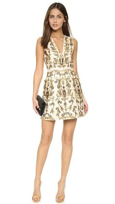 Elaborate beading and metallic embroidery create a lavish pattern on this striking alice + olivia dress. The fitted bodice is styled with a squared V neckline, and wide layers of covered mesh add structure to the hem. On-seam hip pockets. Sleeveless. Lined.